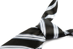 Tie knot with stripes. Elegant casual neck tie knot with stripes on black table Royalty Free Stock Images