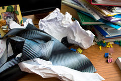 Tie on messy office desk Stock Image
