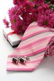 Tie och manschettknappar med blommor Arkivfoto