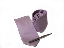 Tie and pen (with pen). Violet tie and pen on white background Royalty Free Stock Images