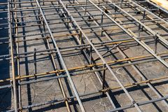Tie rebar beam cage on construction site. Steel reinforcing bar for reinforced concrete.  stock images