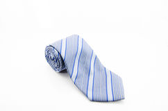 Tie rolled up over white background Stock Image