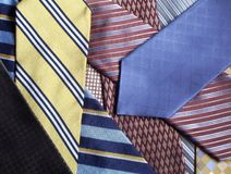 Tie Selection. A Pile of various neck ties royalty free stock photography