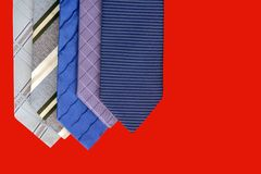 Tie Selection - Red Background. A group of ties to select from isolated on a red background with good copy space Stock Photo