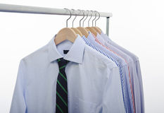 Tie shirts hanger. Hanger with shirts and necktie isolated on white background Royalty Free Stock Photos