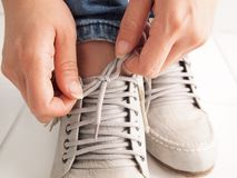 Tie a shoe string. Before leaving the house Stock Image