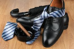 Tie, shoes and men`s accessories. Men`s classic fashion. Shoes with tie Royalty Free Stock Image