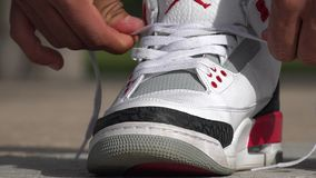 Tie Shoes, Tying Shoe, Shoelaces. Stock video of a man tying his shoes stock footage