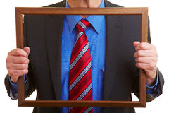 Tie and suit in a frame Stock Photography