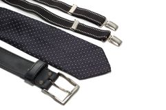 Tie suspenders and belt. Tie, suspenders and belt isolated on white Royalty Free Stock Photography