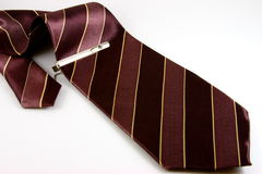 Striped tie. Brown and purple striped tie with a tie pin inscribed with Chinese word for ' long life stock image