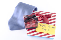 Tie and two gift boxes with card tag write happy father day word. Neck tie and two gift boxes with card tag write happy father day word on a white background Stock Images