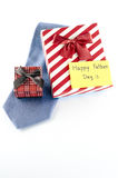 Tie and two gift boxes with card tag write happy father day word. Neck tie and two gift boxes with card tag write happy father day word on a white background Stock Photos