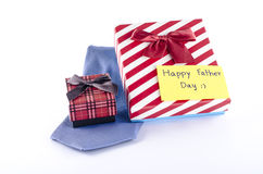 Tie and two gift boxes with card tag write happy father day word. Neck tie and two gift boxes with card tag write happy father day word on a white background Royalty Free Stock Photos