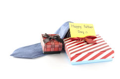 Tie and two gift boxes with card tag write happy father day word. Neck tie and two gift boxes with card tag write happy father day word on a white background Stock Photography
