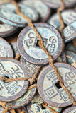 Tied antique Chinese coins on Panjiayuan Market, Beijing, China. Tied antique Chinese coins on Panjiayuan Market, located in south east Beijing, China royalty free stock images