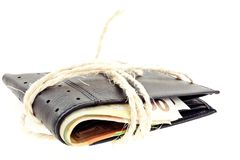 Tied black leather wallet with euro notes Stock Photography