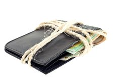 Tied black leather wallet with euro notes Royalty Free Stock Photo