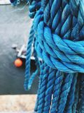 Tied blue rope on the harbour Royalty Free Stock Image