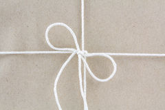 Tied in a bow on a brown recycled paper Stock Photos
