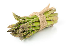 Tied bundle of fresh cut raw, uncooked green asparagus vegetable Royalty Free Stock Images