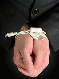 Tied businessman hands. Businessman hands tied with an USB cable Royalty Free Stock Photos