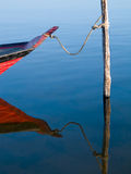 Tied canoe. Canoe with reflection moored in the pole in the river Tapajos - Amazônia Stock Image