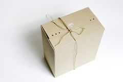 Tied carton. A buff tied rectangle carton is used for package Stock Photography