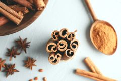Tied cinnamon sticks and other spices. On light background, closeup royalty free stock image