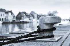 Tied down (Bollard on the dock) Stock Images