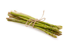 Tied fresh raw asparagus. On white background Stock Images