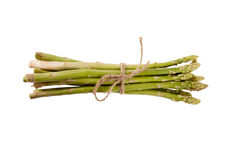 Tied fresh raw asparagus. On white background Royalty Free Stock Photos