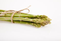 Tied fresh raw asparagus. On white background Stock Image