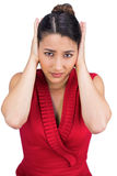 Tied haired brunette covering her ears Royalty Free Stock Photos