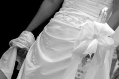 Tied the knot. Bride and goom tied together at the hands royalty free stock photo