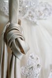 Tied in Knots. Laces on a wedding dress tied in a knot so they don't get dirty stock photos
