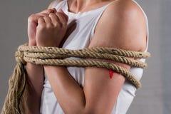 Tied lady. On white shirt suggesting captivity Royalty Free Stock Photos