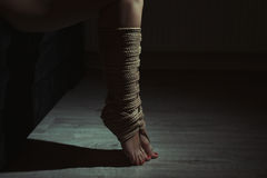 Tied legs. Beautiful legs tied with rope in bondage. Photo toning Royalty Free Stock Photography