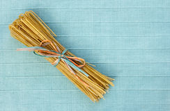 Tied Linguine on Blue Royalty Free Stock Photo