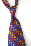 Tied multi-colored tie Stock Images