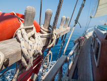 Tied off rope on a  wooden sailing boat Royalty Free Stock Photography