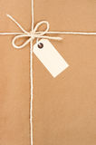 Tied Parcel. Parcel tied with string with address label attached Stock Photography