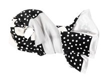 Tied silk scarf sewn from polka dots fabric stock photography