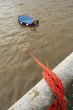 Tied rowboat. Rowboat tied to the shore with a rope Royalty Free Stock Photos