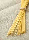 Tied spaghetti with rope on organic bagging. Selective focus Royalty Free Stock Images