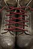 Tied Together. Two leather shoes tied together Stock Image