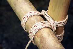 Tied together with a square lashing by scouts Royalty Free Stock Photos