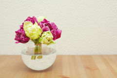 Tied tulips in a glass vase Royalty Free Stock Image
