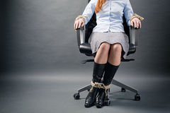 Tied Up Businesswoman in a Chair Royalty Free Stock Images