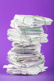 Tied up foot of briefs on a purple background Royalty Free Stock Images